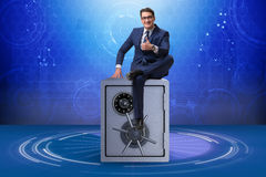 The businessman sitting on top of safe Stock Images