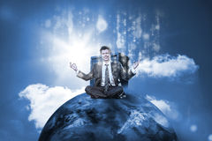 Businessman sitting on top of the world with data server. And glowng matirx on blue sky background royalty free stock image