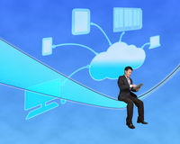 Businessman sitting and touch tablet with cloud computing backgr. Ound in blue sky Stock Photo