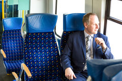 Businessman sitting in a train Royalty Free Stock Photography