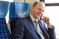 Businessman sitting in a train Stock Photo