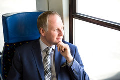 Businessman sitting in a train Stock Images