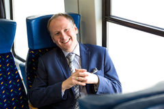 Businessman sitting in a train Royalty Free Stock Photo