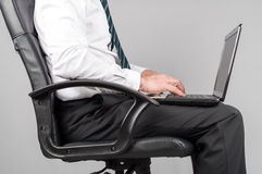 Businessman sitting and typing on his laptop Royalty Free Stock Photo