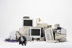 Businessman Sitting By Various Obsolete Technologies Stock Photography