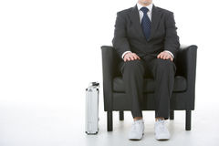 Businessman Sitting Wearing Sneakers Stock Photos