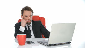 Businessman sitting working at his laptop Stock Photography