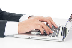 Businessman Sitting Working on Laptop Stock Image