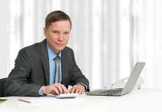Businessman sitting in workplace Royalty Free Stock Photo