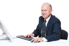 Businessman sitting in workplace and smiling Stock Image