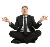 Businessman sitting in yoga position Stock Images