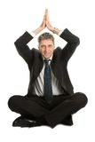 Businessman sitting in yoga position Royalty Free Stock Photos