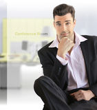 Businessman sitting Stock Images