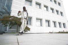 Businessman on skateboard Royalty Free Stock Photography