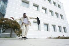 Businessman on skateboard Stock Image