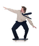 Businessman on skateboard -  Stock Image