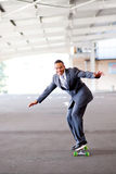 Businessman on skateboard Royalty Free Stock Images
