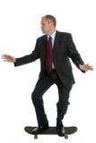 Businessman on a skateboard Stock Image