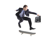 A businessman with skateboard jumping. Isolated on a white background Stock Image