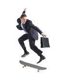 A businessman with skateboard jumping. Isolated on a white background royalty free stock photo