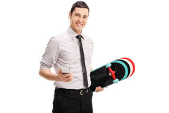 Businessman with a skateboard listening to music Stock Images