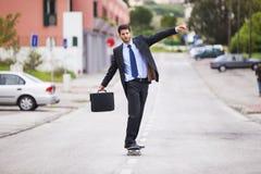 Businessman skateboarding Royalty Free Stock Photos