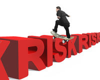 Businessman skating on money skateboard across red risk 3D word Royalty Free Stock Photography