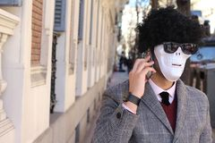 Businessman with skeleton face calling by phone stock photos