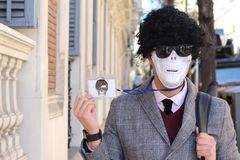 Businessman with skeleton face showing ID.  royalty free stock images