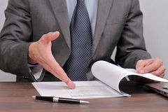 Businessman skeptical reading document close up. Lower disagree with agreement Stock Photos