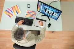 Businessman sketching on graphic tablet Stock Images