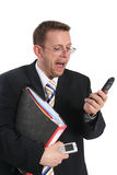 Businessman skreaming at cell phone. And holding folder stock photos
