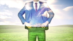 Businessman with sky and grass overlay stock footage