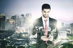 Businessman with skyscraper in the background Stock Photos