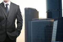 Businessman and skyscraper Stock Photography