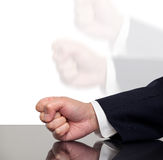 A businessman slamming his fist on a table Stock Photo