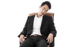 Businessman sleeping on a chair Stock Image