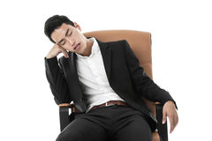 Businessman sleeping on a chair Stock Photos