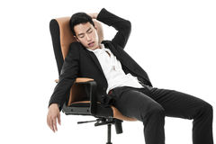 Businessman sleeping on a chair Stock Images