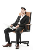 Businessman sleeping on a chair Royalty Free Stock Images