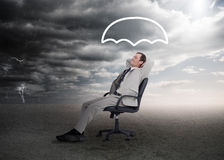 Businessman sleeping in a chair Stock Photography