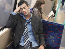 Businessman Sleeping In Commuter Train Royalty Free Stock Photo