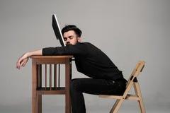 Businessman sleeping on a computer Stock Photo