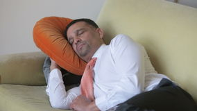 Businessman sleeping on couch in shirt and tie stock video footage
