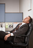 Businessman sleeping at desk Royalty Free Stock Image