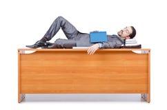 Businessman sleeping at   desk Stock Image