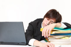 businessman Sleeping on the desk Stock Photography