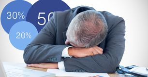 Businessman sleeping on desk by graphics Stock Photo