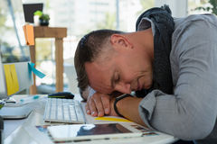 Businessman sleeping at desk in office Royalty Free Stock Photo