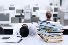 Businessman sleeping at desk Stock Images